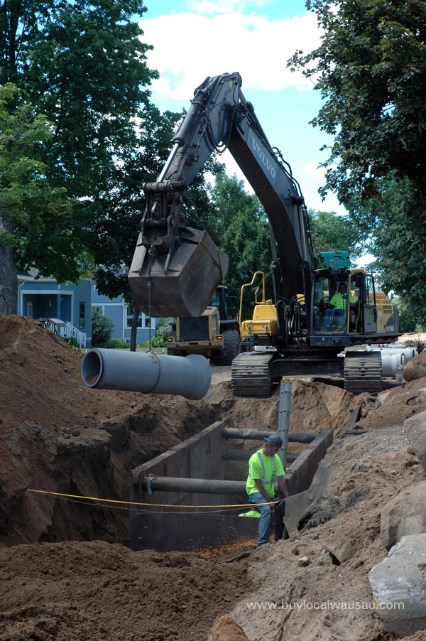 sewer line being lowered
