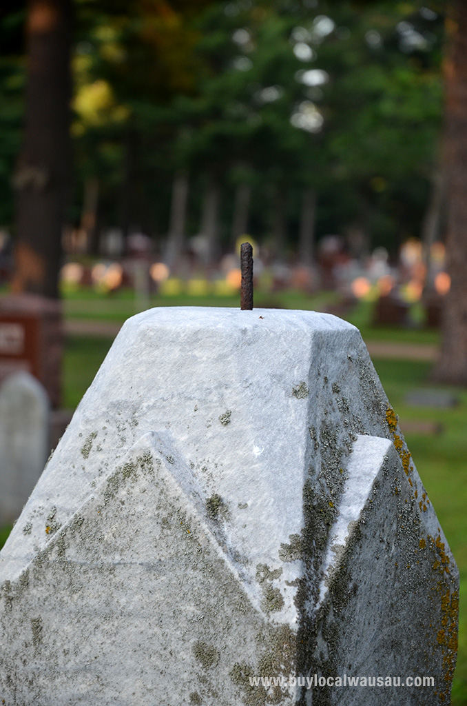 Some of the headstones are missing their finials. Could they be somewhere in the cemetery, or did the perpetrators take them as souvenirs?